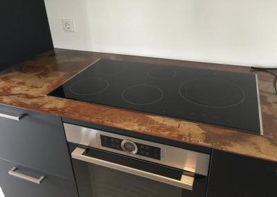 Kookgedeelte keuken, Fenix nano zwarte kasten, blad geroest staal